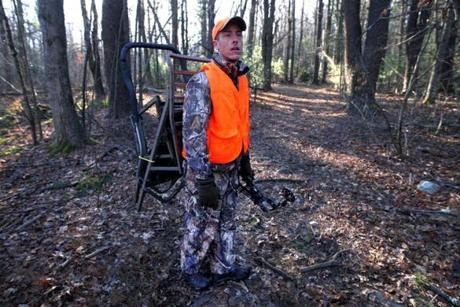 Dover, MA - 12-29-11- Joe Hanley (cq) of Westwood, poses in the woods of Dover where he hunts. (Globe staff photo / Bill Greene) section:wewk, reporter: martinez, topic:08wedeer